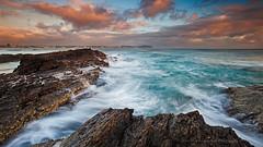 Swept Away (itsgottabered) Tags: ocean longexposure blue sea motion clouds sunrise canon movement rocks surf australia wideangle wash queensland currumbin goldcoast 1740lusm hitechfilters 5dmkii