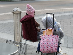 In City Plaza, Raleigh North Carolina, a woman sits............ (Apartment 4 G Photography.....) Tags: park county street leica city trees yards people usa streets weather lady buildings 1 town photo nc women triangle downtown wake ray faces photos south homeless north picture northcarolina center raleigh visit historic convention carolina conventioncenter raleighnc fayetteville unitedway shelters raleighnorthcarolina wakecounty cityplaza buildngs fayettevillestreet raleighconventioncenter downtownraleigh fayettevilestreet bestcity rayrivera cityofoaks greatamericancity rayriveraphoto raleighcityplaza ncrayriveraphotoray visitraleigh