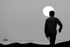 Boat & person.. (Mike-Lee) Tags: sunset sea sun india mike person boat blackwhite jill silhouettes mumbai bandstand bandra bandstandbeach feb2012