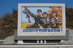 Propaganda from the Wonsan/Hamhung region, North Korea (Joseph A Ferris III) Tags: art poster soldier workers propaganda communism flame korean socialism northkorea dprk juche