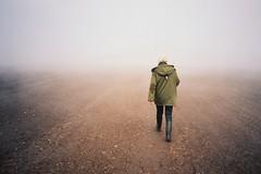 (Aage Drake) Tags: woman field fog walking denmark leaving island haze earth desolate wellies barren olympusxa disappearing kodakportra160 sejer parkacoat