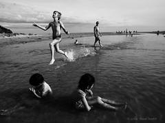 Takeoff (gahenty) Tags: sea blackandwhite bw monochrome blackwhite streetphotography streetscene monotone seashore swd e5 beachscene childrenplaying streetcandid 1260mm
