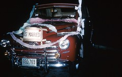 Just Married, 1949 (Alan Mays) Tags: old decorations brown signs men cars ford night vintage dark virginia superdeluxe women funny humorous married darkness photos getaway humor couples headlights ephemera nighttime 1940s photographs marriages kodachrome autos amusing streamers wives justmarried slides pranks automobiles husbands 1949 newlyweds licenseplates convertibles windshields transparencies practicaljokes foundphotos steeringwheels honeymoons crepepaper redborder getawaycars