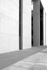 (Delay Tactics) Tags: light blackandwhite bw white abstract black berlin monochrome architecture concrete shadows pavement sidewalk column tones paullbehaus