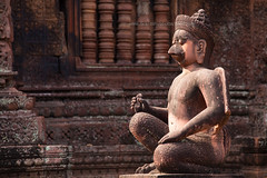 Banteay Srei (baddoguy) Tags: red sculpture history statue horizontal architecture outdoors photography sandstone cambodia sitting khmer religion nopeople angkorwat unescoworldheritagesite shiva siemreap angkor hinduism ancientcivilization mythology elegance banteaysrei artandcraft traveldestinations famousplace internationallandmark pinkcolor siemreapprovince templebuilding malelikeness humanrepresentation builtstructure eastasianculture stonematerial cambodianculture animalrepresentation carvingcraftproduct