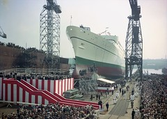 Launch of the passenger liner 'Empress of Canada' (Tyne & Wear Archives & Museums) Tags: roof light shadow sky people abstract blur industry beautiful bar stairs buildings river design daylight interesting construction cabin industrial ship arm unitedkingdom crane stripes coat leg platform bank rail vessel flags passengers cranes chain deck walker crew transportation porthole gathering archives unusual lovely launch shipyard majestic tyneside crowds newcastleupontyne fascinating digitalimage observing rivertyne shipbuilding shiplaunch industrialheritage colourphotography walkernavalyard navalyard northeastofengland passengerliner shipbuildingheritage maritimeheritage colourphotograph canadianpacificsteamships empressofcanada newcastleswingbridge sirwgarmstrongwhitworthcoltd vickersarmstrongltd highwalker elswickshipyard 10may1960