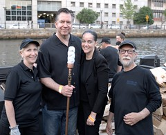 Guest Lighters preparing for the procession! (waterfireprov) Tags: torch woodboat guestlighters wfvolunteer bankofamericalighting