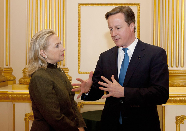 Prime Minister David Cameron talks to US Secretary of State Hilary Rodham Clinton