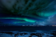 Polarlichter (swissgoldeneagle) Tags: winter light sea snow cold norway night photoshop lights meer nacht norwegen aurora modified astronomy kalt dunkel northernlights auroraborealis borealis tromsø norther polarlicht cs5 polarlichter d700