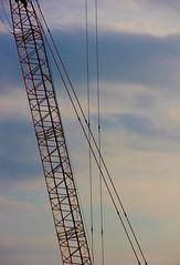 IMG_1784 (Allison.J.) Tags: blue sky orange lines metal clouds construction industrial crane holyoke linear
