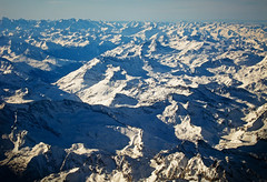 Over the top of the Alps (bobaliciouslondon) Tags: from sky snow mountains alps window aeroplane alpine thealps peaks