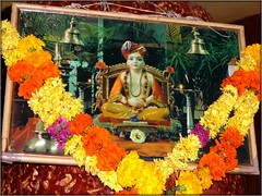 Hindu God in a Shiva Temple (Ginas Pics) Tags: flowers flower religious temple god avatar goddess garland holy destroyer devotion sacred offering wisdom shiva krishna lingam puja darshan prosperity hindufestival goodfortune lifeinindia avatra