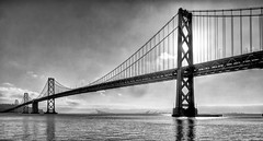 Backlit Bay Bridge (phomchick) Tags: sanfrancisco bw baybridge canons100