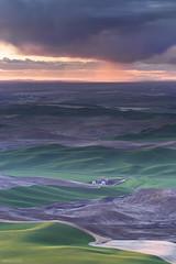 Palouse Sunset Shower (Bill Devlin) Tags: sunset cloud green field rain shower washington butte farm hills rolling contours palouse steptoe