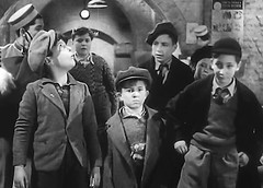 Using clothing to steal the scene (theirhistory) Tags: uk london film boys hat kids children war wwii kinderen tie crime jacket cap gb ww2 jumper 1942 adults villians bfilm johntacchi