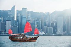Hong kong (Patrick Foto ;)) Tags: ocean china wood city travel blue red sea sky hk building tourism water skyline modern sailboat skyscraper port vintage landscape island hongkong harbor boat wooden junk asia downtown day ship tour flag traditional transport sightseeing chinese sunny vessel landmark center tourist hong kong business transportation sail mast concept kowloon navigate yonagoshi