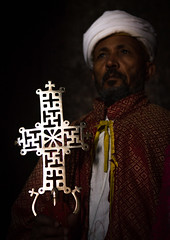 Ethiopian orthodox priest holding a cross inside a rock church, Amhara region, Lalibela, Ethiopia (Eric Lafforgue) Tags: africa travel portrait man color men vertical outdoors worship cross adult african faith religion unescoworldheritagesite celebration holy indoors sacred priest christianity shawl spirituality ethiopia orthodox religiouscelebration oneperson traditionalculture lalibela hornofafrica ethiopian eastafrica thiopien etiopia abyssinia ethiopie traditionalclothing etiopa darkbackground onlymen onemanonly waistup onematuremanonly  etiopija 1people ethiopi  africanculture etiopien etipia  etiyopya  amhararegion         semienwollozone ethio163567