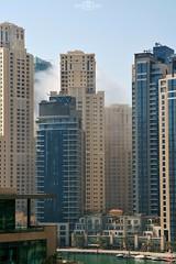 Cloud between buildings - Dubai Marina, UAE (kadryskory) Tags: trip travel urban cloud water skyline marina buildings boat dubai uae dubaimarina kadryskory