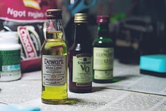 DSC_0004 (ngotpquang) Tags: old blue light canada yellow vintage table scotland three bottle wine small liquor alcohol tiny whisky