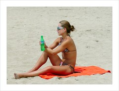 Beautyful girl on the beach . (Franc Le Blanc) Tags: people bali beach girl lumix sitting candid drinking towel panasonic sit seated pantai kuta