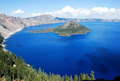 Crater Lake, Oregon (WorldofArun) Tags: park trees panorama mountain lake snow reflection water clouds oregon sunrise landscape island volcano lava nationalpark nikon shoreline rocky august crater caldera collapse craterlake eruption phantomship wizardisland klamath stratovolcano craterlakenationalpark 2011 18200mm llaorock rimdrive volcaniceruption mountmazama rimvillage d40x worldofarun klamathtribe arunyenumula deepestlakeinunitedstates klamathnativeindians