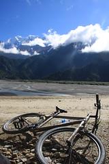 Taking a break from Mountain biking on a Multi sport treking Mountain biking rafting kayaking trip in Nepal