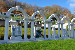 Child Graves in Aberfan Cemetery (Simon Downham) Tags: life flowers england mountain news black mountains green history monument loss cemetery grave childhood statue wales angel children death sadness memorial mine village child play god hill prayer pray praying memories innocent pit mining hills angels tragedy valley disaster memory innocence why coal mound tragic weeping prayers grief weep prays coalmine goverment inquiry catastrophic catastrophe grieving enquiry innocents investigation merthyr ncb slurry bereft accountability slagheap coalpit culpable smother aberfan bereavement culpability nationalcoalboard dsc0497 inquirey enquirey