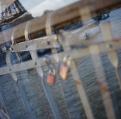 River Seine (Laurence Le Gall Photography) Tags: light paris seine docks river holga doubleexposure eiffeltower padlocks kodakportra400 laurencelegall