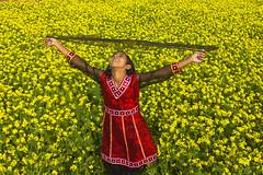 in yellow.. (auniket prantor) Tags: flower girl smile field children asian happy asia mustard dhaka enjoying bangladesh yello mustered cropland smilinh