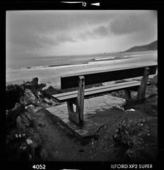 seat with a view (jory4) Tags: 120 film beach blackwhite holga lomo log sand surf surfer lofi surfing devon longboard ilford lineup braunton