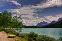 Where known things feel so soothing (JoLoLog) Tags: trees lake canada mountains clouds joe alberta rockymountains banffnationalpark canadianrockies icefieldparkway highway93 canonxsi upperwaterfowllake