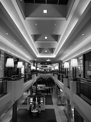 Polaris Mall (tim.perdue) Tags: columbus ohio people bw white black fashion retail mall shopping lights place balcony olympus ceiling hallway railing stores figures zuiko e600 polaris 1454mm