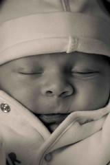 Wrapped up warm (JGent1980) Tags: portrait baby white black up hat comfortable warm close