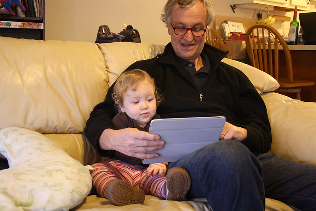 Cuddling up with Grandpa and the iPad