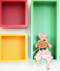 Eat ALL the candies!! (AnnuskA  - AnnA Theodora) Tags: red portrait baby green colors smile yellow happy photography kid colorful child candy adorable lovely pirulito colorido