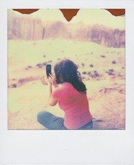 Picture Taker (t knouff) Tags: camera red woman film girl beauty polaroid sx70 utah sandstone phone cellphone samsung canyon instant moab redrock impossible coloradorivercanyon instantfilm px70 impossibleproject galaxynexus