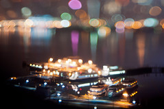 Ferries (daniellih) Tags: new york city nyc newyorkcity light sky urban cloud newyork blur color reflection building water ferry skyline modern night skyscraper buildings river landscape march harbor boat miniature newjersey blurry dock colorful downtown cityscape dof view bokeh free shift shore jersey hudsonriver scape tilt urbanscape 2012 weehawken lensing tiltshift hamiltonpark freelensing