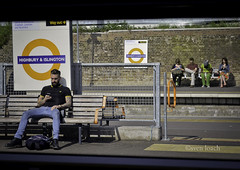 Time Killers (Sven Loach) Tags: uk england london window station mobile bench beard spring nikon waiting sitting afternoon boots britain streetphotography cell sunny tattoos passengers jeans mustache publictransport islington overground phones bloke fredperry texting docmartens tfl northlondon highburyislington d5100