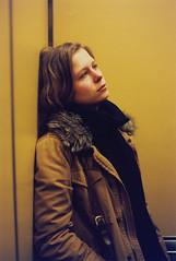 Eugenie (The Frotographer) Tags: light portrait newyork colors elevator 35mmfilm yellows somber eugenie greenwichvillage goingdown nikonf5