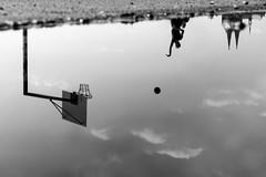 Waterworld (explored) (.niraw) Tags: bw basketball wasser wolken kln asphalt spiegelung gegenlicht klnerdom deutz pftze basketballkorb deutzerwerft sprungwurf strasenfotografie niraw