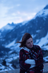Mountain morning (pass_the_popcorn) Tags: morning blue winter portrait woman snow mountains alps girl beautiful beauty sunrise model purple bluesky headshot valley poncho swissalps brownhair swissmountains grimsel