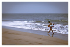 Spring days at the beach (s1nano) Tags: sea seascape beach lensbaby spring sand dof child bokeh wave greece swimmer thalassa doubleglass kakovatos nikond7000