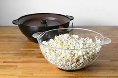 popcorn in bowl on table (yourbestdigs) Tags: wood food white hot yellow bag movie table yummy healthy corn junk sweet salt tasty fair bowl pop sugar gourmet pot kettle salty butter snack popcorn carbohydrates treat buttered stir snacking canola kernel refreshment buttery salted kettlcorn