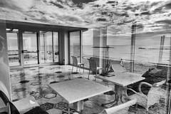 meanwhile at the sea... (Yossarian Lo Svedese) Tags: mare miller cielo sedie riflessi bianco nero spazio tavoli tropico abbandono surreale