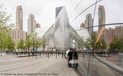 WTC Transportation Hub and 9/11 Museum Reflection (DSC05221-Pano-Edit) (Michael.Lee.Pics.NYC) Tags: panorama newyork reflection museum architecture memorial cloudy sony worldtradecenter 911 wtc santiagocalatrava transportationhub voigtlanderheliar15mmf45 a7rm2