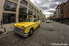 Historic Yellow Cab (Serapic) Tags: street new york old city nyc urban usa cloud ny history car yellow clouds america canon cab taxi giallo gianlucaserafini