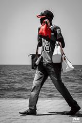 Sell a Bag (Van Esch Design (VED)) Tags: ocean red sea people blackandwhite water bag walking boulevard walk sell