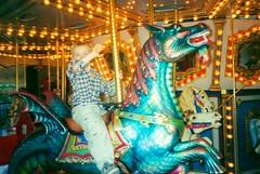 GRANDSON RIDING FIRST MERRY GO ROUND 2002 (roberthuffstutter) Tags: memories daughter grandchildren grandson grandaughters merrygorounds huffstutter