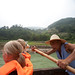 Boatman rows sampan on Shennong Stream