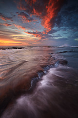 Fire in the Sky (Xenedis) Tags: ocean morning seascape water clouds sunrise flow dawn rocks australia nsw newsouthwales cascade narrabeen